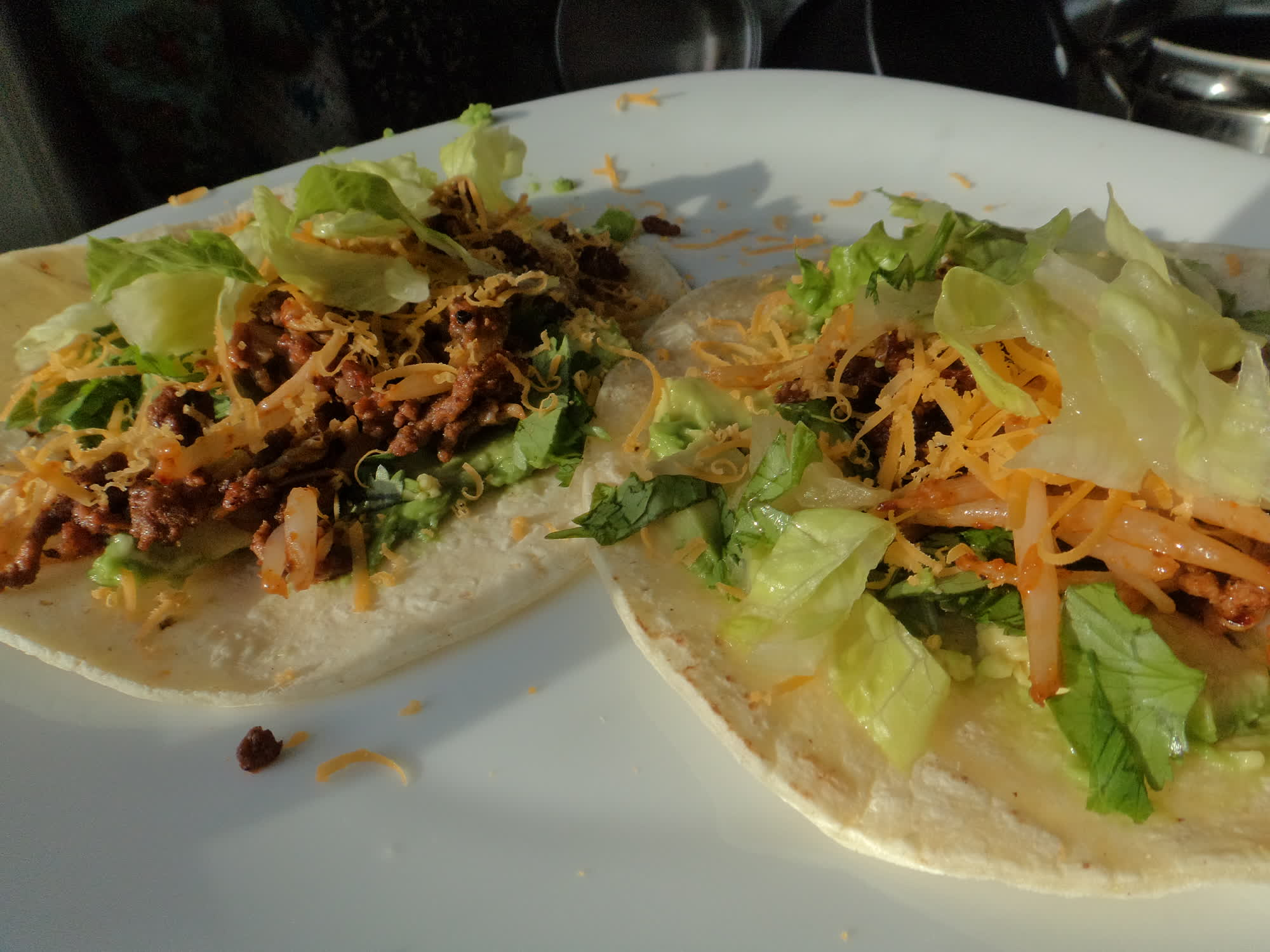 Spicy beef taco with fried bean sprouts and cheese.