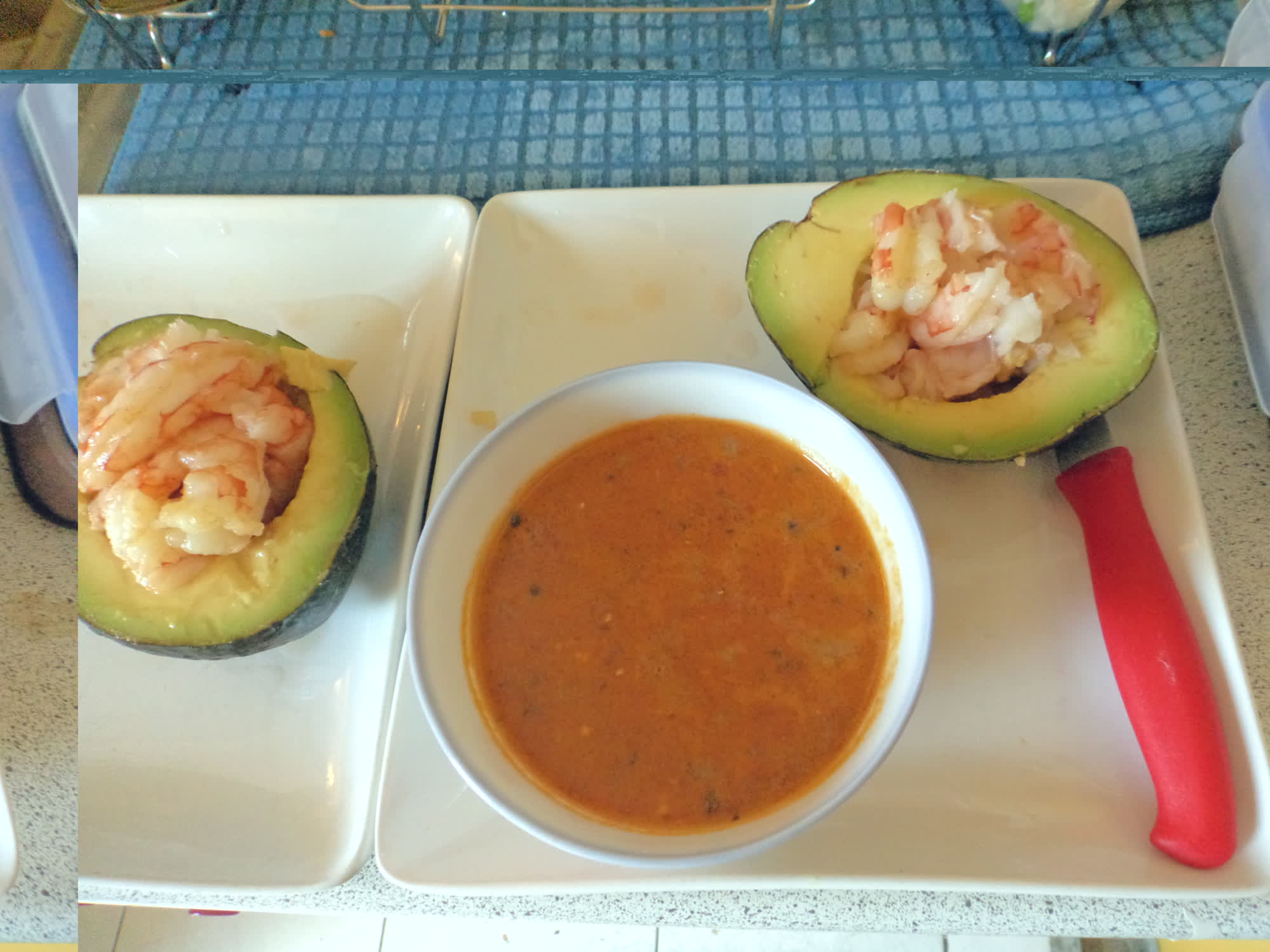 Tomato soup with shrimp-stuffed avocado.
